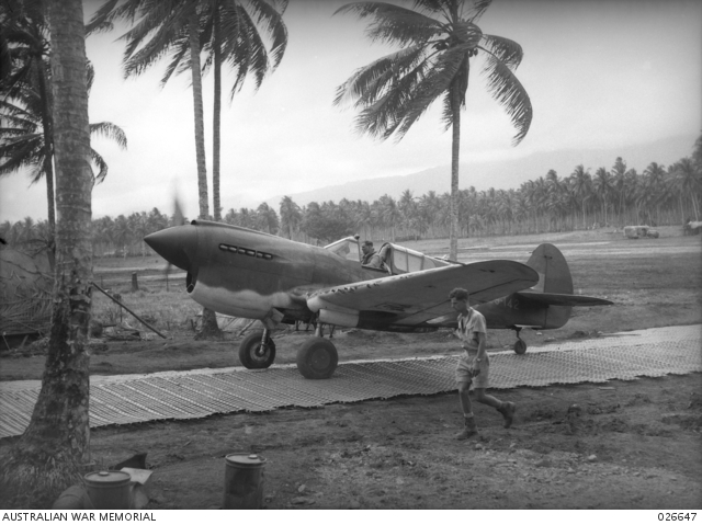 An RAAF P-40 Kittyhawk in PNG in WW2. By the time the strip at Nadzab was available in 1943 the USAAF was making use of more advanced aircraft.