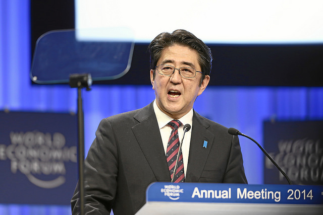Shinzo Abe, Prime Minister of Japan talks to the audience during the session 'The Reshaping of the World: Vision from Japan' at the Annual Meeting 2014 of the World Economic Forum at the congress centre in Davos, January 22, 2014.