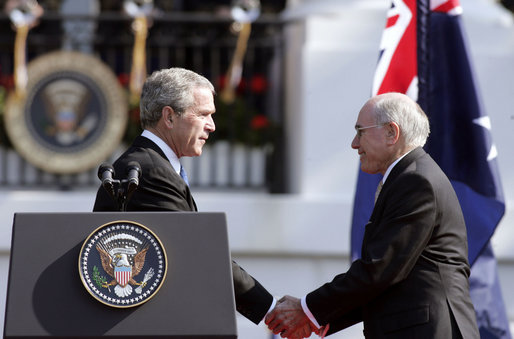 "After delivering his remarks, President George W. Bush shakes hands with Australian Prime Minister John Howard during the State Arrival Ceremony held for the Prime Minister on the South Lawn Tuesday, May 16, 2006. ""Freedom has enemies, and for more than a hundred years, Australians and Americans have joined together to defend freedom,"" said President Bush. ""Together we fought the Battle of Hamel in World War I. Together we fought in World War II from the beaches of Normandy to the waters of the Coral Sea. Together we fought in Korea and Vietnam. And together we're fighting, and winning, the global war on terror."" White House photo by Paul Morse"