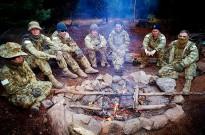 Australian Defence Force Academy (ADFA) third year undergraduates, keep warm during the ADFA Exercise Leadership Challenge III.