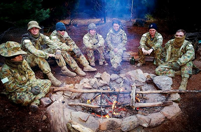 Australian Defence Force Academy (ADFA) third year undergraduates, keep warm during the ADFA Exercise Leadership Challenge III.