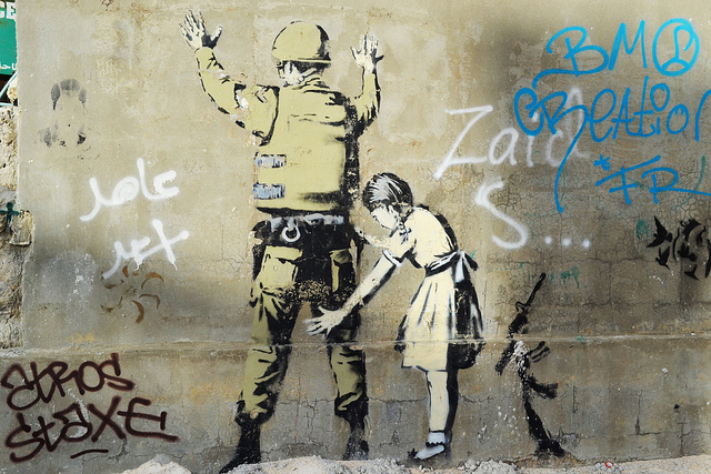 Banksy's 'Girl and a Soldier', stencilled onto the wall of the West Bank in Bethlehem.