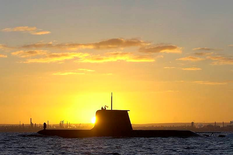 HMAS Collins transits through Cockburn Sound at sunrise.