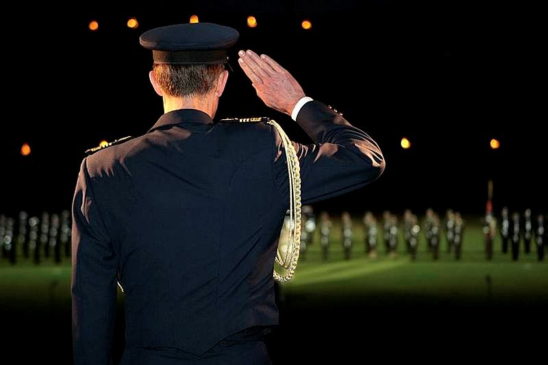 Then Chief of the Defence Force, Air Chief Marshal Angus Houston, AC, AFC, returned the salute of Australia's Federation Guard at the beginning of the Edinburgh Military Tattoo, which was held at the Sydney Football Stadium in 2010.