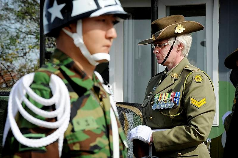 Corporal Catherine Sturge (right), Australia's Federation Guard, guards the Battle of Maryang San memorial as a member of the catafalque party during the 60th anniversary wreath-laying ceremony at the Taepung observation post in South Korea.