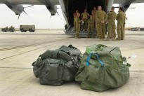 Australian Defence Force members receive a brief prior to flying on mission into South Sudan.