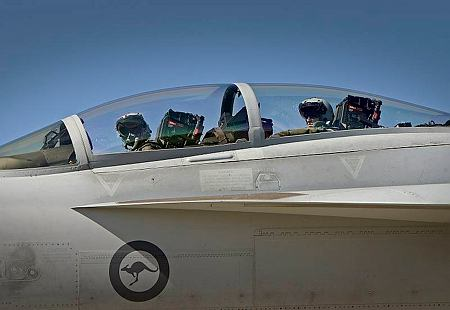 RAAF F/A-18F Super Hornet aircrew depart for morning sortie.