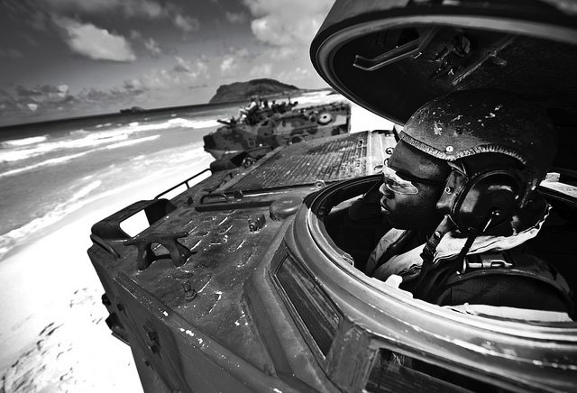 A Marine Corps a R7-A1 amphibious assault vehicle driver assigned to Combat Assault Company, 3rd Marine Regiment, Marine Corps Base Hawaii - Kane'ohe Bay waits on Pyramid beach for the authorization to close the hatch and head into the ocean July 12, 2012, to meet up with the USS Essex (LHD-2) off shore.