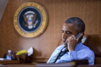 President Barack Obama talks on the phone aboard Air Force One with President Petro Poroshenko of Ukraine about the Malaysia Airlines plane crash in eastern Ukraine, July 17, 2014.