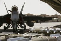 A Royal Australian Air Force F/A-18F Super Hornet loaded with explosive ordnance in the Middle East.