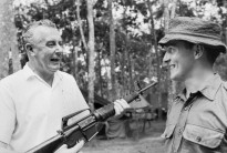 Phuoc Tuy Province, Vietnam. 10 October 1966. Gough Whitlam, then Deputy Leader of the Federal Opposition, has a laugh during a talk with Private Wayne Weldon of the 6th Battalion, Royal Australian Regiment.