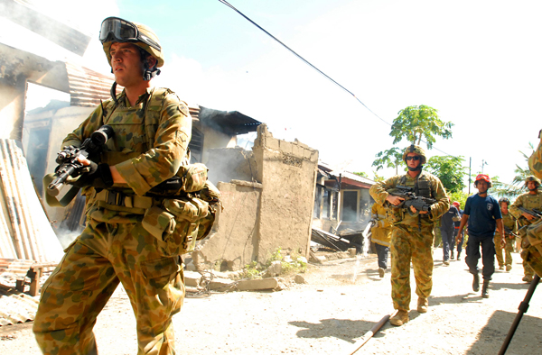A platoon from the 3rd Battalion Group provides security to the Dili Fire Service.  (Date taken: 02 June 2006)