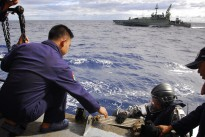 Following a successful boarding exercise, HMAS Maryborough's Petty Officer Bosun Michael Cunnington, is assisted by an Indonesian sailor at the completion of a boarding exercise with Indonesian Warship KRI Wiratno during the first Australian-Indonesian Coordinated Patrol.