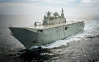 The largest ship ever built for the Royal Australian Navy, Landing Helicopter Dock NUSHIP Canberra, passes through Sydney Heads for the first time. She will be commissioned into the RAN as HMAS Canberra.