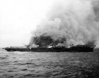 USS Lexington (CV-2), burning and sinking after her crew abandoned ship during the Battle of Coral Sea, 8 May 1942.