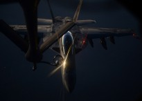 A U.S. Air Force KC-135 Stratotanker aircraft refuels a Navy F/A-18F Super Hornet aircraft assigned to Strike Fighter Squadron (VFA) 213 over Iraq Aug. 21, 2014.