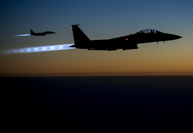 Two U.S. Air Force F-15E Strike Eagle aircraft fly over northern Iraq Sept. 23, 2014, after conducting airstrikes in Syria. The aircraft were part of a large coalition strike package that was the first to strike Islamic State of Iraq and the Levant (ISIL) targets in Syria. President Barack Obama authorized humanitarian aid deliveries to Iraq as well as targeted airstrikes to protect U.S. personnel from extremists known as ISIL. U.S. Central Command directed the operations. (DoD photo by Senior Airman Matthew Bruch, U.S. Air Force/Released)