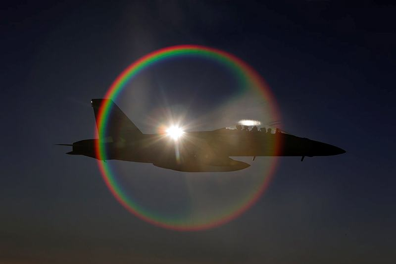 A Royal Australian Air Force F/A-18F Super Hornet, with the sun directly behind it, provides an unusual but spectacular sight during a mission in the skies over Iraq.