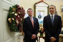 President Barack Obama and Ashton Carter wait in the Oval Office doorway before entering the Roosevelt Room where the President announced Carter's nomination for Defense Secretary, Dec. 5, 2014. (Official White House Photo by Pete Souza)