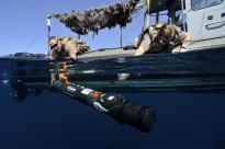 GULF OF OMAN (Nov. 4, 2014) Aerographer's Mate 2nd Class Robert Carlson (left) and 3rd Class Rachel Myers, assigned to Commander, Task Group 56.1, deploy a MK 18 MOD 2 Swordfish to survey the ocean floor during the International Mine Countermeasure Exercise (IMCMEX).