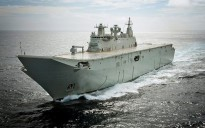 The largest ship ever built for the Royal Australian Navy, Landing Helicopter Dock NUSHIP Canberra, passes through Sydney Heads for the first time.