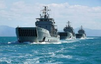 The Royal Australians Navy's Landing Craft Heavy (LCH) HMA Ships Brunei, Labuan and Tarakan depart Cairns Harbour in formation.