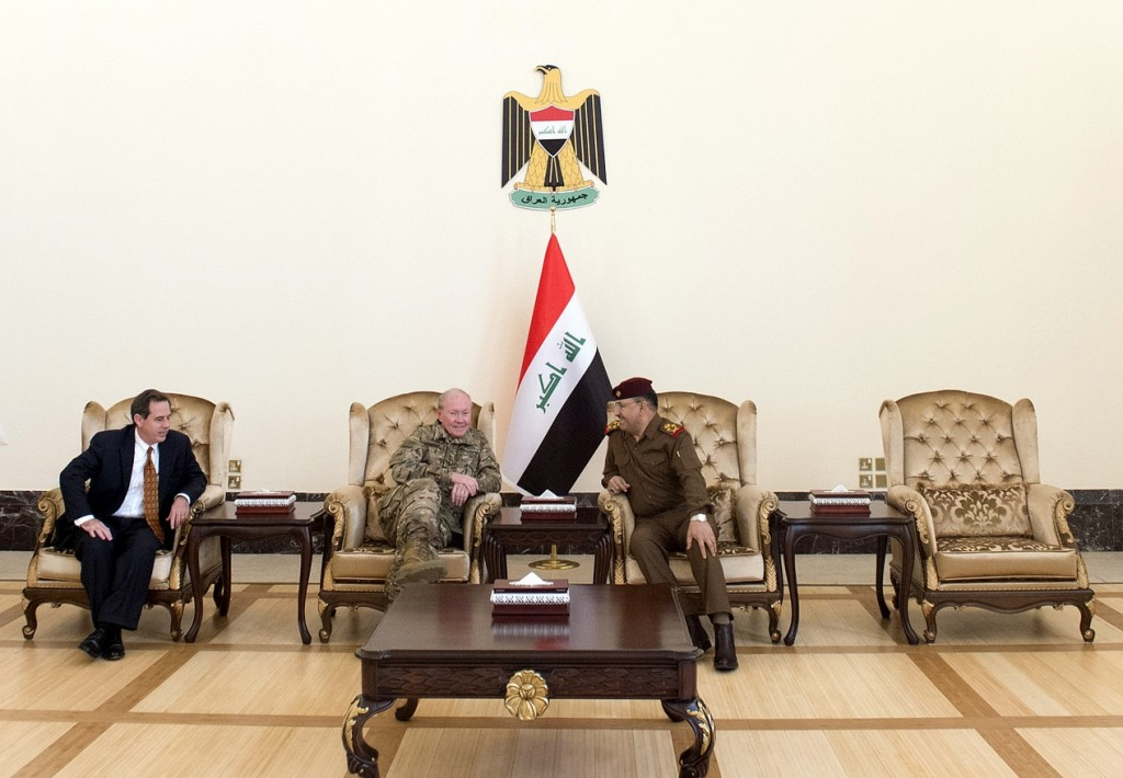 A senior Iraqi military officer waits with US Chairman of the Joint Chiefs of Staff, Gen. Martin E. Dempsey, and US Ambassador to Iraq, Stuart E. Jones, prior to a meeting with the Iraqi Prime Minister in Baghdad International Airport in Baghdad, Iraq, Mar. 9, 2015. (DOD photo by D. Myles Cullen/Released)