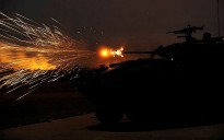 An ASLAV from the 2nd Cavalry Regiment fires its 25mm Bushmaster cannon during a night live-fire practise at Mount Bundey training area during Exercise Eagle's Run.