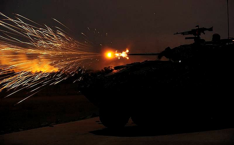 An ASLAV from the 2nd Cavalry Regiment fires its 25mm Bushmaster