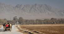 Australian Bushmasters escort a Dutch crane into the Baluchi Valley, Southern Afghanistan, to facilitate repairs to an essential town bridge.