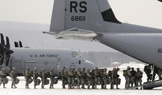 U.S. Army paratroopers from the 173rd Airborne Brigade Combat Team, from Vicenza, Italy, file into a C-130J Super Hercules at Ramstein Air Base, Germany, on Feb. 10, 2012.