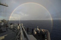 PACIFIC OCEAN (July 25, 2014) A rainbow arches near the amphibious dock landing ship USS Rushmore (LSD 47) as it transits the Pacific Ocean for a photo exercise during Rim of the Pacific (RIMPAC) Exercise 2014.