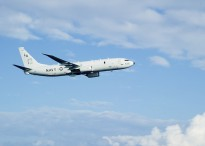 """PHILIPPINE SEA (Sept. 26, 2014) A P-8A Poseidon, assigned to the """"Mad Foxes"""" of Patrol Squadron (VP) Five from Okinawa, Japan, conducts a fly-by near amphibious assault ship USS Peleliu (LHA 5)."""