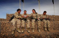 1st Mentoring and Reconstruction Task Force mothers (left to right) Sergeant Donna Bourke, Warrant Officer Class Two Cassandra Jones, Corporal Nicole Spohn and Corporal Ivona Bartusch share photos of their kids as they celebrate Mothers Day in Tarin Kowt, Afghanistan.