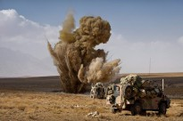 A controlled detonation of an Improvised Explosive Devise (IED) explodes in front of an Australian Bushmaster during a move down one of the most dangerous IED routes in the region to conduct disruption operation in Northern Kandahar.