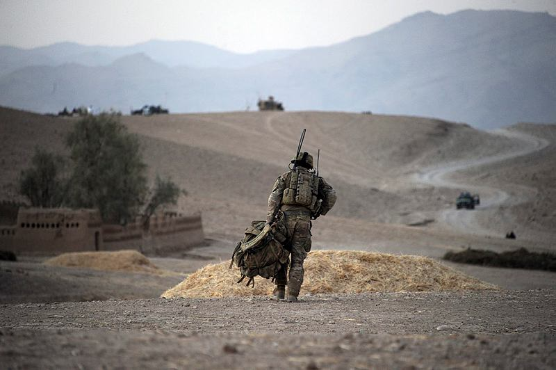 An Australian soldier from Mentoring Task Force – Three carries his pack near the town of Saghaytu after taking part in an Afghan National Army coordinated clearance of the Khod Valley, southern Afghanistan.