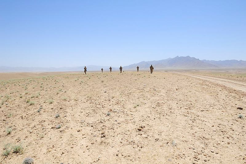 Members of Mentoring Team One, part of Mentoring Task Force - Four, move across the the 'Dasht' (desert) during a mentored patrol with members of the Afghanistan National Army in Uruzgan Province, Afghanistan.