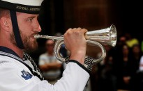 The Bugle player of the Royal Australian Navy Band, Sydney Detachment, plays the last post during the 72nd Anniversary Marking the loss of HMAS Sydney II, held at the Cenotaph, Martin Place, Sydney.