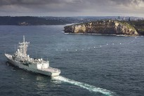HMAS Sydney enters Sydney Harbour for the last time while flying her decommissioning pennant.