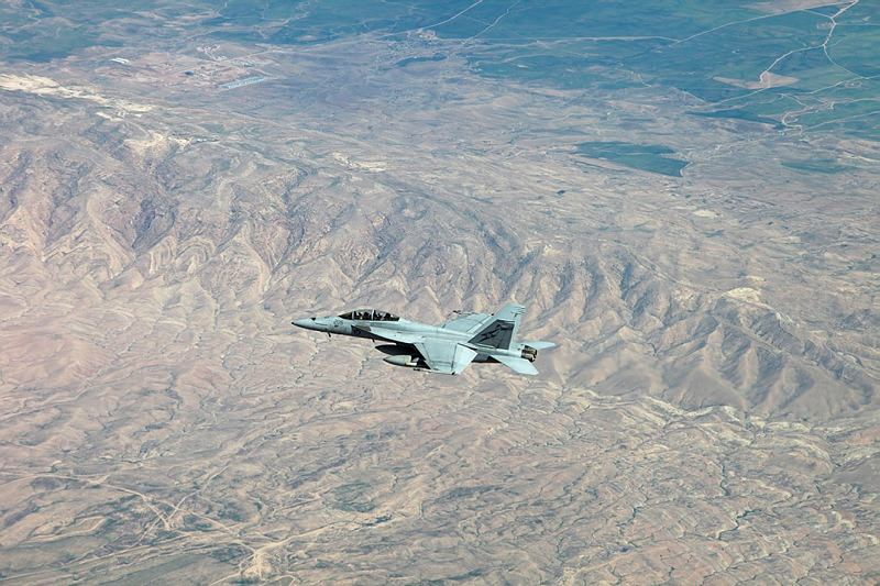 A RAAF F/A-18F Super Hornet flies formation with an RAAF KC-30 tanker aircraft during a mission in the Middle East Region for Operation OKRA. During the mission recently arrived F/A-18 Hornets flew alongside of F/A-18F Super Hornets that would soon return to Australia.