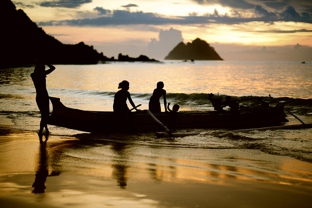 In the fading hours of a golden sunset on Selong Belanak beach, Lombok.
