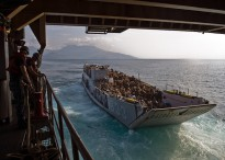 SOUTH CHINA SEA (June 27, 2013) Landing Craft Utility (LCU) 1633 exits the well deck of the forward-deployed amphibious dock landing ship USS Tortuga (LSD 46).