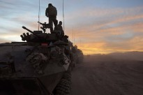 Soldiers from the 1st Mentoring and Reconstruction Task Force prepare to leave their base on a joint Australian and Dutch Patrol as the sunrises over Southern Afghanistan.