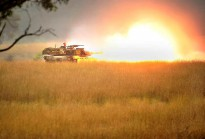 An Abrams M1A1 Tank provides intensive fire support while assaulting an enemy position during Exercise Chong Ju.