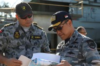 Lieutenant Commander Mark Sorby (left), from Headquarters Northern Command, provides a briefing to Lieutenant Colonel Dickry Rizanny, Commanding Officer of the Indonesian patrol boat KRI Tombak, following the successful conclusion of the 2015 Australian-Indonesian Coordinated Patrol.