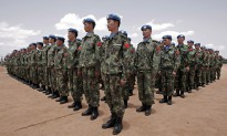 Newly arrived engineers from China serving with the United Nations-African Union Mission in Darfur (UNAMID) stand to attention after arriving in Nyala, South Darfur.