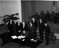 Secretary of State Dean Acheson is shown signing Tripartite Security Treaty (ANZUS)
