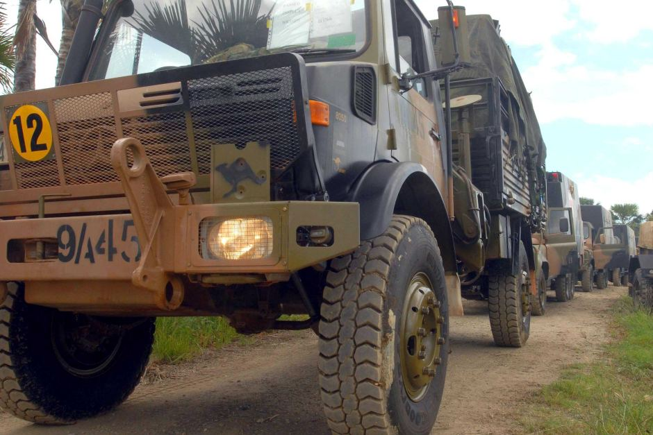 An Australian Army Unimog truck, along with other Australian Army vehicles prepare to drive into Dili after a beach landing in the Comoro district of Timor-Leste.
