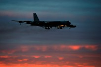 Edited USAF image of a B-52 bomber flying at sunset.