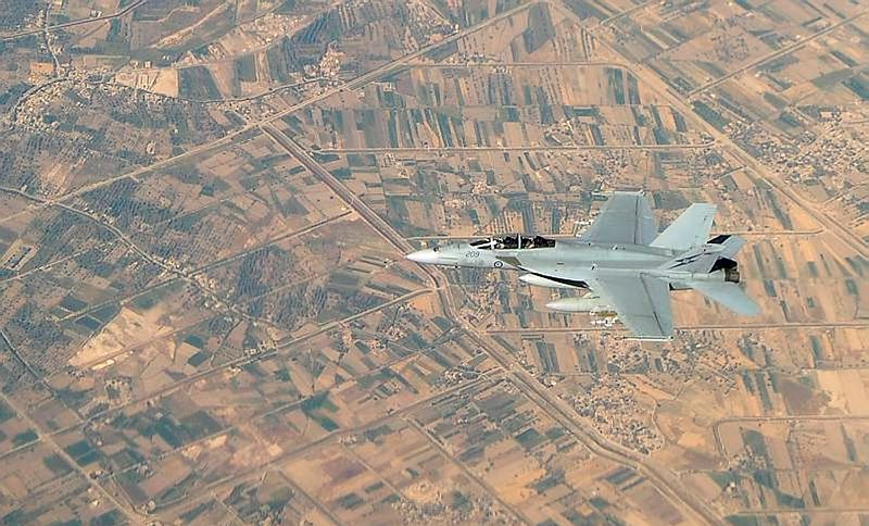 A Royal Australian Air Force F/A-18F Super Hornet aircraft sorties through the skies of Iraq on an Australian Air Task Group mission.